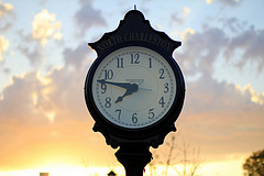 Flickr Creative Commons image of a clock with a sunset in the background