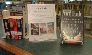 A display of Ann Rule's books on a counter in the reference area.