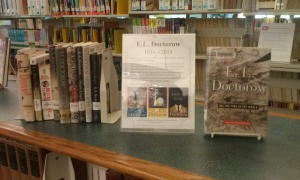 Sign for E.L. Doctorow and a display of his books on a counter top in the reference area
