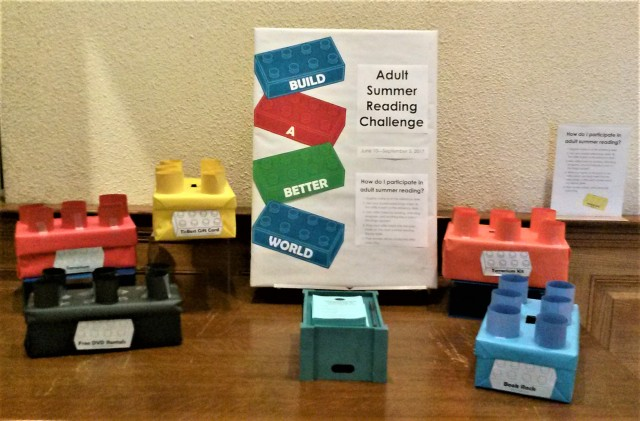 Summer Reading display table with Lego brick prize boxes