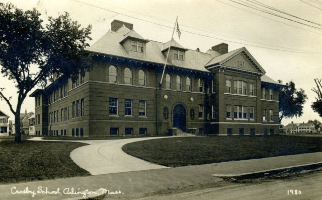 Circa 1915 post card view of Crosby School. Built in 1896, with a 1911 addition to the right of the main entrance. From 1917 to 1950, the East Branch Library was located in the basement room to the furthest right in this image. (Courtesy Arlington Historical Society)
