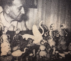 "Retiree William B. Fleming of 306 Appleton St., ""Artist in Sea Shells"" with some of his creations exhibited at the East Branch Library in 1949. (Arlington News photograph)"