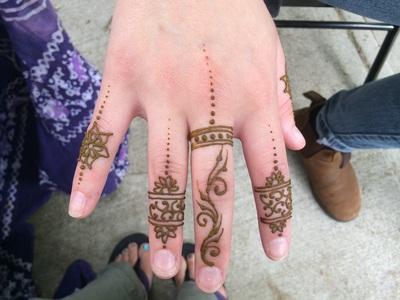 A hand with a henna tattoo