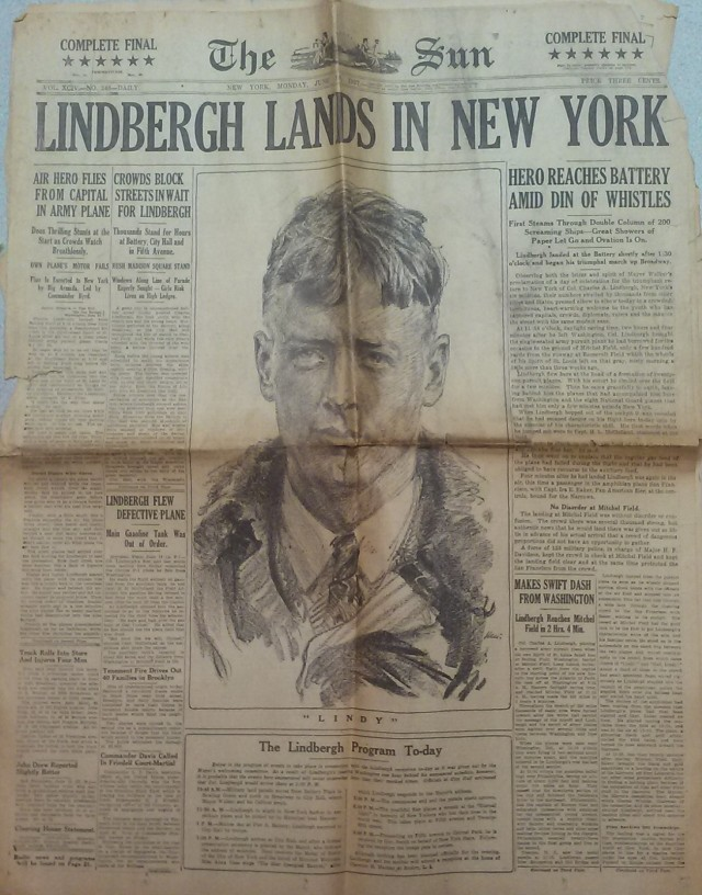 Photo of the front page of The Sun from June 13, 1927, headline LINDBERGH LANDS IN NEW YORK