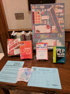 NaNoWriMo display table with poster, books, and handouts