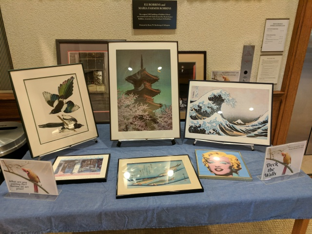 Display table showing framed art prints